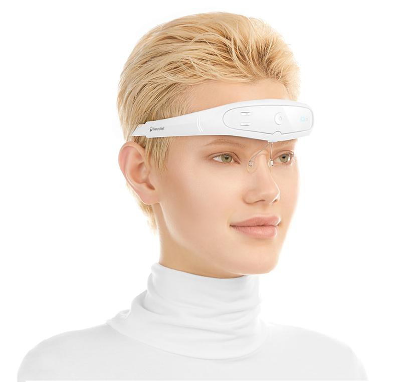 A woman wearing a digital headband